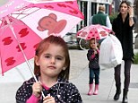 Bring it on! Alessandra Ambrosio's daughter Anja is rainy day chic with designer umbrella and matching boots