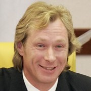 Former Soviet international midfielder Alexei Mikhailichenko smiles as he gives a news conference af