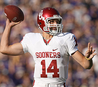 Sam Bradford shows off his skills against the Huskies by finishing with six total TDs.  (Getty Images)