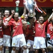Manchester United players celebrate with the trophy after beating Chelsea in the final of the UEFA C