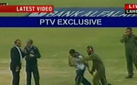Sri Lankan players run to the helicopter that will take them to safety