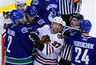 Canucks left winger Darcy Hordichuk and defenceman Mattias Ohlund surround Chicago Blackhawks right winger Adam Burish in the second.