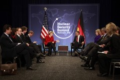 U.S. President Barack Obama (R) listens to German Chancellor Angela Merkel during their bilateral meeting at the Nuclear Security Summit in Washington April 13, 2010.