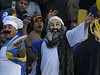 A supporter of Boca Juniors' dressed up as Al-Qaeda chief Osama Bin Laden, holds a plastic chicken, before the start of the Argentina's first division football match between Boca and River Plate at La Bombonera stadium, in Buenos Aires, on March 25, 2010. Boca won 2-0.