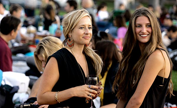 London socialite Tamsin Lonsdale, left, chats with Michele Ouellet. Lonsdale runs the Supper Club.