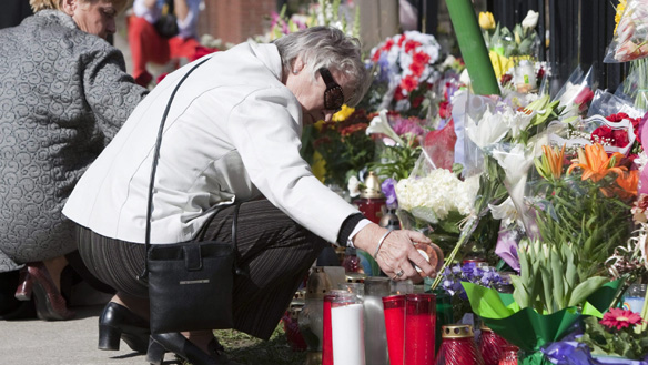 Kristina Buchzynska, right, and Halina Hyla tend to a shrine to victims of the plane crash, including Polish President Lech Kaczynski, outside the Polish Consulate in Toronto on Sunday.