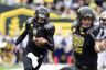 EUGENE OR - NOVEMBER 6: Quarterback Darron Thomas #1 of the Oregon Ducks runs toward the end zone and a touchdown in the second quarter of the game against the Washington Huskies at Autzen Stadium on November 6 2010 in Eugene Oregon. (Photo by Steve Dykes/Getty Images)
