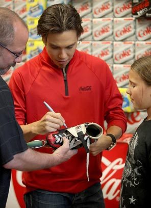 Apolo Ohno, shown signing autographs last year at the University Village QFC in Seattle, could walk away from Vancouver with endorsements worth millions of dollars.