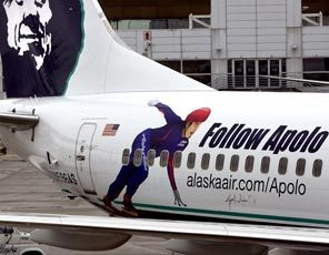 An image of Apolo Ohno is painted on an Alaska Airlines Boeing 737-800, showing the carrier's sponsorship of the speedskater.