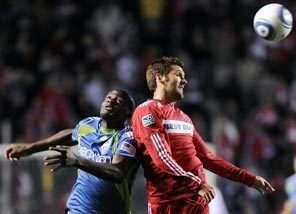 Sounders FC's Blaise Nkufo, left, and Gonzalo Segares of the Chicago Fire vie for the ball.