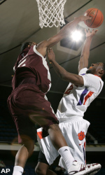 Texas A&M guard Dash Harris, left, defends as Clemson guard Tanner Smith tries to score. (AP)