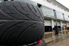 A wet Bridgestone tyre.