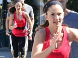 No wonder she's running away! Minka Kelly gets put through the pace on jog with her trainer