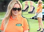 Not ideal: Aubrey O'Day golfed in sky-high wedges