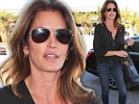 Model partier: A make-up free Cindy Crawford looks flawless the day after a night of Oscar parties