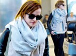Never an off-duty day: Emma Watson shows off her dressed down traveller style as she makes her way through the airport