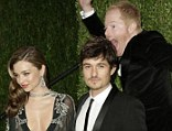 Photobomb! The stars let down their hair at the annual Vanity Fair post-Oscars bash, with Jesse Tyler Ferguson happily jumping into a shot of Miranda Kerr and Orlando Bloom