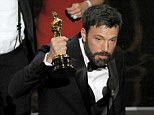 Well that's one way to celebrate: Ben Affleck shaves off his beard at Oscars after-party following Argo win