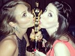 Sealed with a kiss! Stacy Keibler and pal pucker up to boyfriend George Clooney's Best Picture Oscar