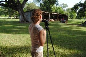 Stephanie Nelson is recording footage for the historic landscape maintance training video.