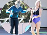 That's more like it! Kendra Wilkinson strips to a one-piece after nearly taking a tumble in her wetsuit while practising for Splash