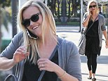 Not just a pretty face: Reese Witherspoon looks casual but chic at an international ideas conference