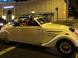 The Bazmobile: Baz Bamigboye drove this white 1938 Peugeot Eclipse - complete with red leather upholstery - to the Vanity Fair Oscar Party