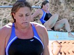 Making a Splash! Nicole Eggert shows off her toned figure after intensive training for diving show