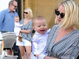 Happy family: Kelsey Grammer, wife Kayte, and baby Faith