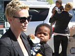 Grocery shopping never looked so stylish! Sleek Charlize Theron cuddles son Jackson as they stock up at Whole Foods