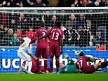 Winner: Luke Moore scores from close range to earn all three points for Swansea
