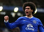 Punching his weight: Fellaini is jubilant after his opening goal