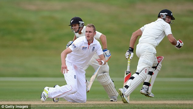On their knees: Stuart Broad falls over as BJ Watling and Jimmy Neesham of a New Zealand XI score runs