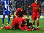 Game, set and match: The Uruguayan completed his hat-trick just after half-time to put Liverpool 4-0 ahead