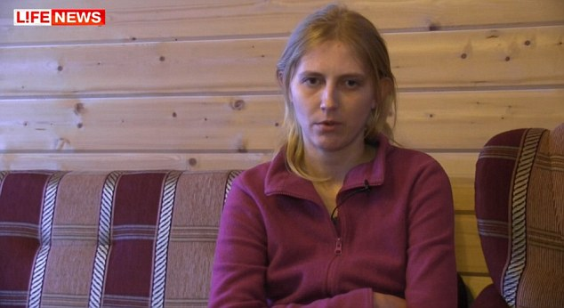 Plea: In a tightly choreographed interview, Max's biological mother, 23-year-old Yulia Kuzmina, tearfully appealed to President Putin to have her surviving son returned to her