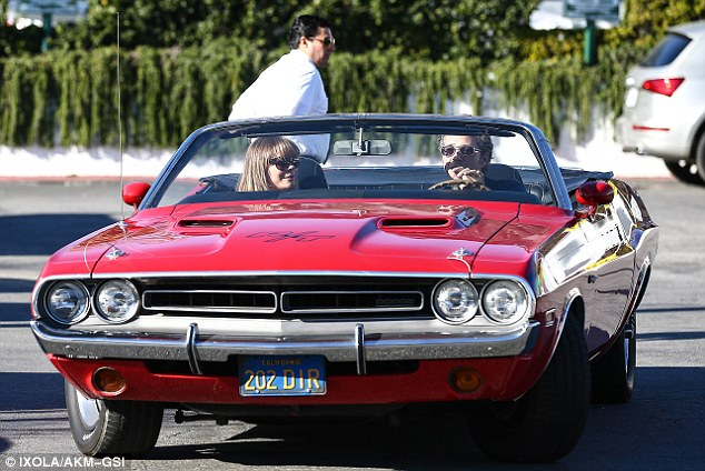 Off for a spin: Berger was close with Rimes, seen here in his Dodge RT muscle car, back when she was married to Dean Sheremet