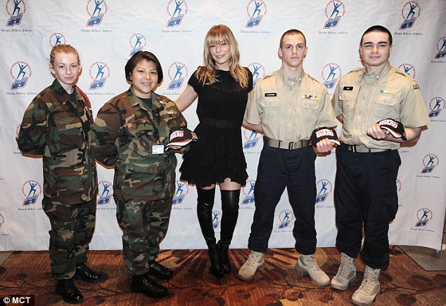 Country star: On Tuesday, LeAnn wore over-the-knee boots to perform at the Youth National Guard Challenge in Washington, DC