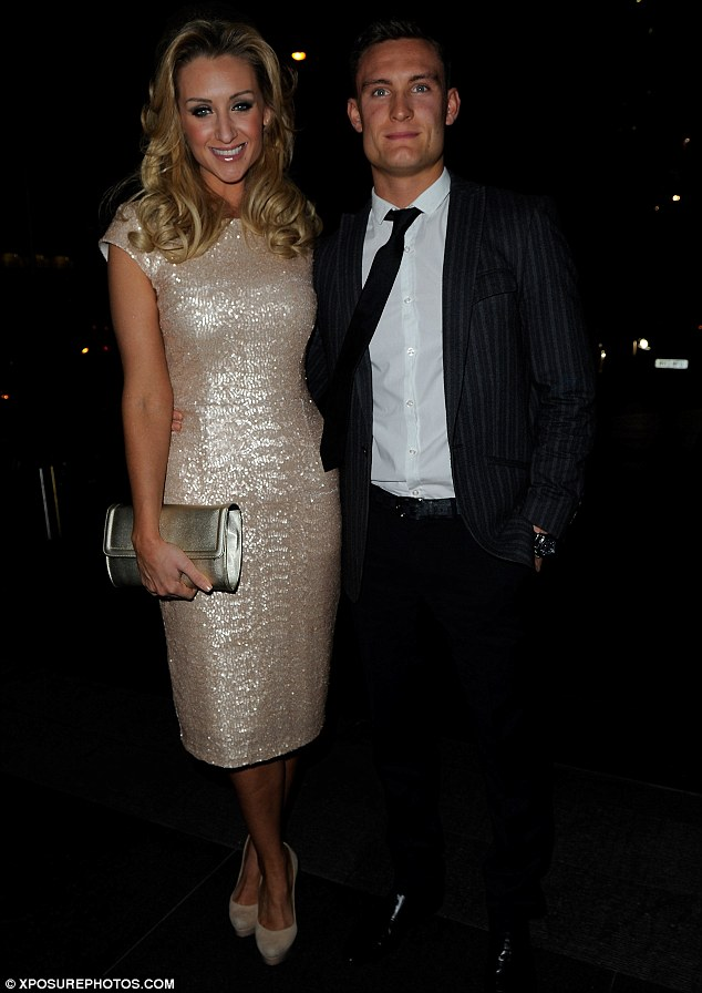 Beautiful: Catherine Tyldesley stunned at the Child Line ball in Manchester on Saturday with her boyfriend Sam Whitter