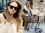 Runaway trolley! Natalie Portman struggles to contain her tipping load of groceries on trip to Gelson's