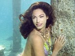 Kelly Brook shows off her impressive curves in mermaid costume as part of water campaign