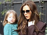 She's growing up so fast! Harper Beckham was seen wearing her hair down as Victoria carried her as the designer rain errand in London