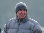 Confident mood: Ferguson shares a joke with Wayne Rooney in training this morning