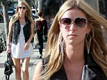 Feeling shirty! Nicky Hilton struts around Beverly Hills in short cotton dress and leather waistcoat