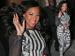 Ashanti goes overkill in garish black and white patterned outfit... as she reveals her bra in see-through top