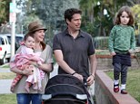 The look of love: Alyson Hannigan took her family for an early evening walk to Kay and Dave's in Brentwood on Sunday