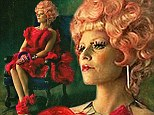 Lady in red! Elizabeth Banks dons bold new look in first sneak peak at The Hunger Games: Catching Fire