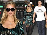 Paris Hilton pulls on her favourite suspender tights as she dines out with beau River Viperi after birthday weekend
