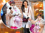 First ballet, then Mandarin and now tennis! Multi-talented Suri Cruise, six, wields pink racquet as Katie Holmes takes her to upscale sports club