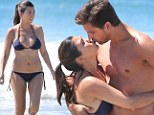 Her besotted boyfriend Scott Disick couldn't keep his hands off the 33-year-old as she sunned herself in a bikini in Mexico during a family vacation.