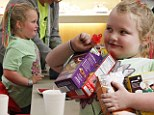 Following the rules! Honey Boo Boo pitches in to flog Girl Scout cookies with her local troop after being banned from online sales